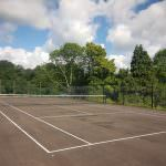 Full size tennis court, fenced tennis court,